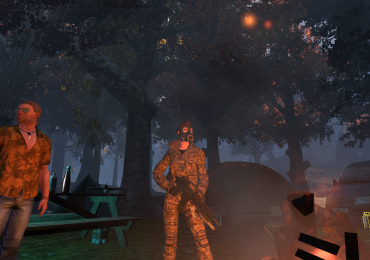 Commando with gas mask by a campfire